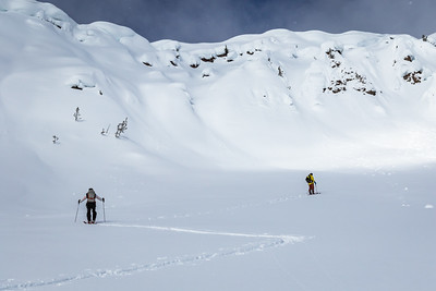 Sawyer Thomas and Riis Wilbrecht skiining up Republic Peak. For John Colter Project.