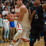 Chase Shellman (23) forced his way past North Oldham\'s Jonathan Henry (15).