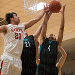 DeSales\' Chase Shellman (23) mixed it up with North Oldham\'s Brent Anderson (21) and Jalen Henry (4) to grab a rebound.