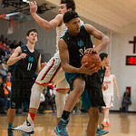 North Oldham\'s Travis Brown (34) came up with a rebound.