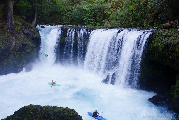 Kayakers dropping in on Spirit Falls on the Little White Salmon River, Cook, WA.