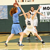 STAN HUDY - SHUDY@DIGITALFIRSTMEDIA.COM<br /> Columbia's Grace Heeps (23) looks to break through the Shenendehowa zone and  Alex Tudor (33) with Cat Almeida (11) under the basket Friday, Jan. 20, 2017 during their Suburban Council game at Shenendehowa High School.