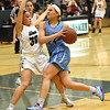 STAN HUDY - SHUDY@DIGITALFIRSTMEDIA.COM<br /> Columbia sennior Selena Lott drives the lane in front of Shenendehowa freshman guard Simone Walker in the second half  in a battle of top 10 teams in New York State Friday, Jan. 20, 2017.