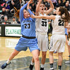 STAN HUDY - SHUDY@DIGITALFIRSTMEDIA.COM<br /> Columbia's Grace Heeps heads towards teh basket along side Shenendehowa's Alex Tudor(33) and Claire Drum (22) Friday, Jan. 20, 2017 during their Suburban Council game at Shenendehowa High School.