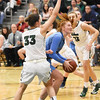 STAN HUDY - SHUDY@DIGITALFIRSTMEDIA.COM<br /> Columbia's Grace Heeps is determined to drive by Shenendehowa's Alex Tudor under the basket Friday, Jan. 20, 2017 during their Suburban Council game at Shenendehowa High School.