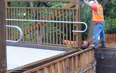 Mounting bolts appear to line up nicely as City of Chico construction crews install a footbridge over Comanche Creek Friday May 6, 2016. (Bill Husa -- Enterprise-Record)