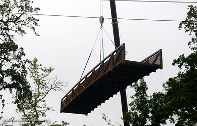 A crane carefully lifts the bridge into place as City of Chico construction crews install a footbridge over Comanche Creek Friday May 6, 2016. (Bill Husa -- Enterprise-Record)