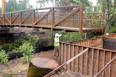 Things appeared to go very smooth as City of Chico construction crews install a footbridge over Comanche Creek Friday May 6, 2016. (Bill Husa -- Enterprise-Record)