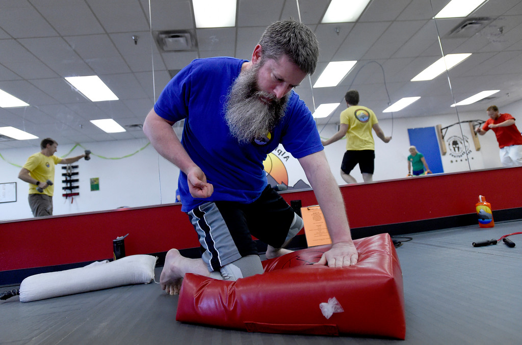. Jerry Moncrief works out with others during a combat fitness class at Boulder Karate on Wednesday in Boulder. For more photos of the combat fitness class go to www.dailycamera.com Jeremy Papasso/ Staff Photographer/ April 20, 2017
