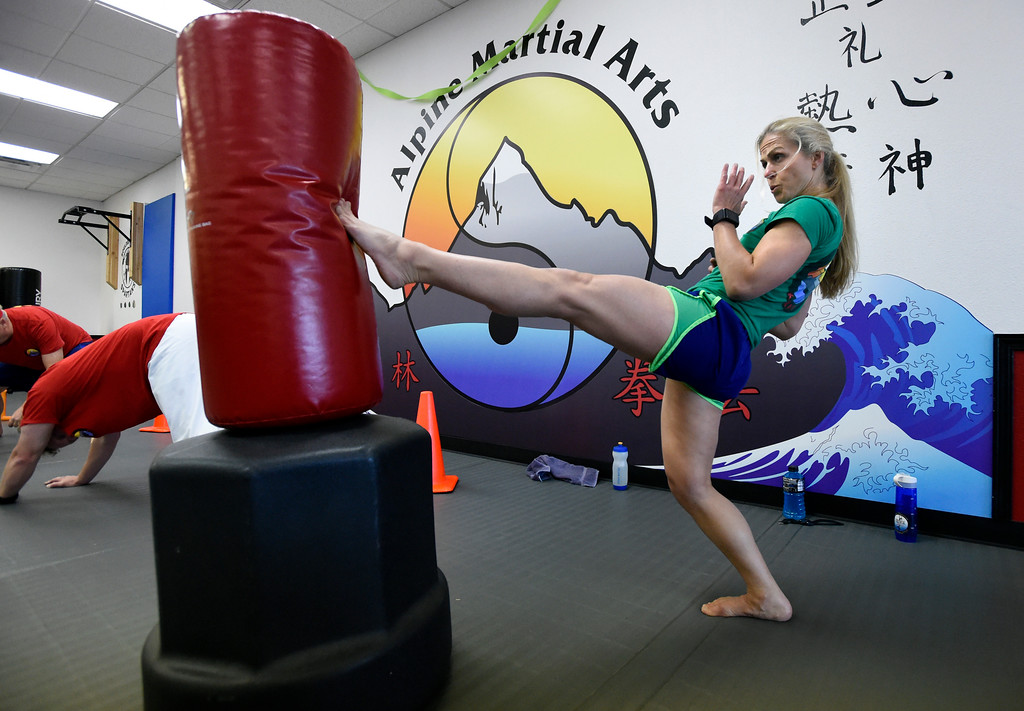. Rachel Mahloch works out during a combat fitness class at Boulder Karate on Wednesday in Boulder. For more photos of the combat fitness class go to www.dailycamera.com Jeremy Papasso/ Staff Photographer/ April 20, 2017