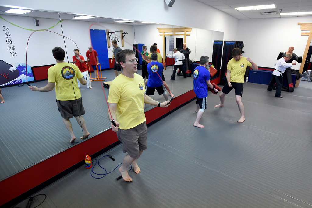 . John Ciminski, at left, works out during a combat fitness class at Boulder Karate on Wednesday in Boulder. For more photos of the combat fitness class go to www.dailycamera.com Jeremy Papasso/ Staff Photographer/ April 20, 2017