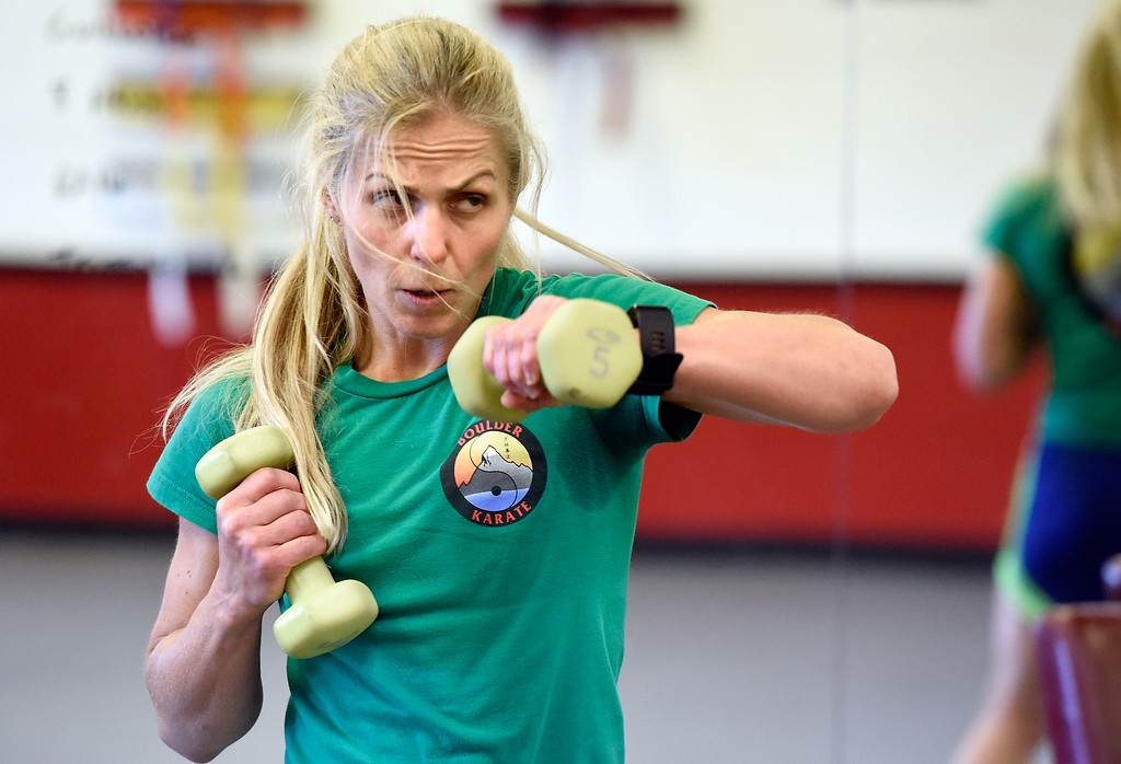 . Rachel Mahloch works out with dumbells during a combat fitness class at Boulder Karate on Wednesday in Boulder. For more photos of the combat fitness class go to www.dailycamera.com Jeremy Papasso/ Staff Photographer/ April 20, 2017