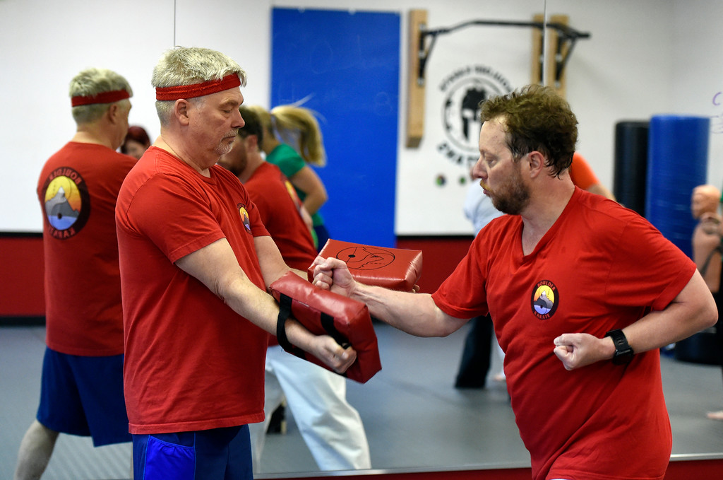 . David James, left, and Keith Jarvis work out together during a combat fitness class at Boulder Karate on Wednesday in Boulder. For more photos of the combat fitness class go to www.dailycamera.com Jeremy Papasso/ Staff Photographer/ April 20, 2017
