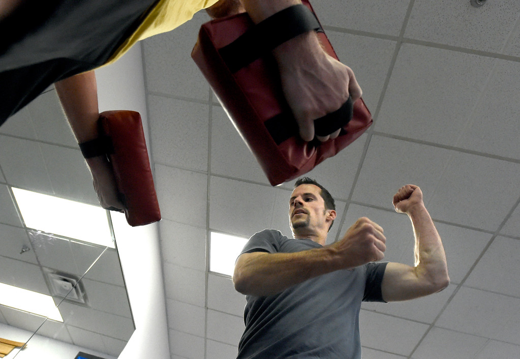 . Owner Brad Randolph works out during a combat fitness class at Boulder Karate on Wednesday in Boulder. For more photos of the combat fitness class go to www.dailycamera.com Jeremy Papasso/ Staff Photographer/ April 20, 2017