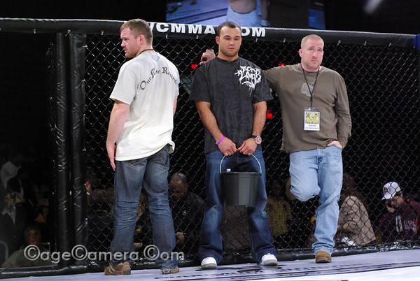 Losing is never easy, even for the cornermen. Matt Hughes is on the left.