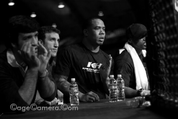 The faces of these cornermen say it all. Whatever is going on in the cage can't be good.