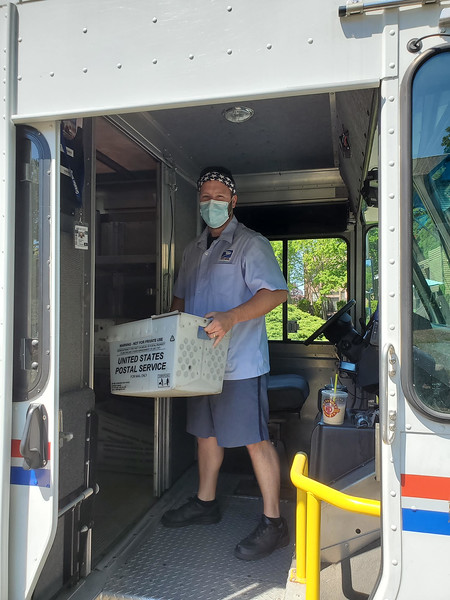 Chelmsford carrier Anthony Bossi delivers express mail.