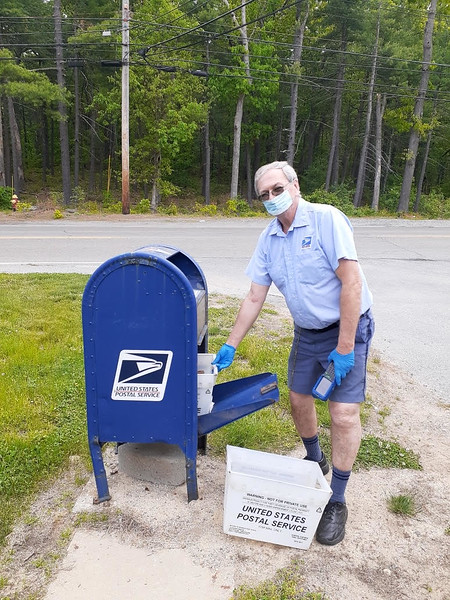 Billerica carrier John Janowicz collects outgoing mail.