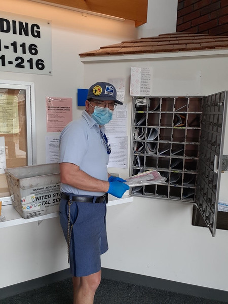 Chelmsford carrier Jim Salvati delivers mail to an apartment complex.