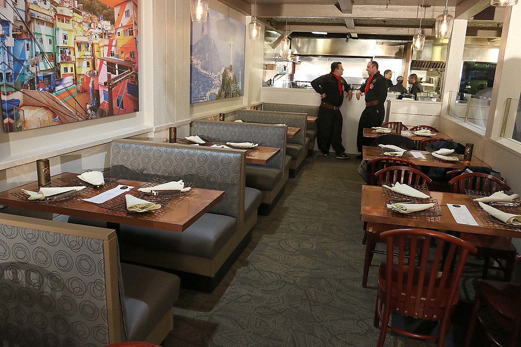 . Comeketo Brazilian Steakhouse in Leominster held a ribbon cutting on Friday afternoon to show off their newly renovated restaurant. Some of the new seating area. SENTINEL & ENTERPRISE/JOHN LOVE