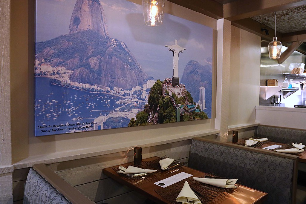 . Comeketo Brazilian Steakhouse in Leominster held a ribbon cutting on Friday afternoon to show off their newly renovated restaurant. This pictures of the Christ the Redeemer Statue in Rio de Janeiro is one of the many pictures from Brazil that now hang on the wall of the newly renovated restaurant. SENTINEL & ENTERPRISE/JOHN LOVE