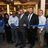 Comeketo Brazilian Steakhouse in Leominster held a ribbon cutting on Friday afternoon to show off their newly renovated restaurant. Leominster Mayor Dean Mazzarella stands to the right of Owner Rodrigo Souza as he cuts the ribbon on Friday afternoon to open his newly renovated restaurant. Wityh them are other local officals and members of the North Central Ma Chamber of Commerce. SENTINEL & ENTERPRISE/JOHN LOVE