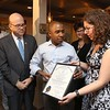Comeketo Brazilian Steakhouse in Leominster held a ribbon cutting on Friday afternoon to show off their newly renovated restaurant. Congrtessman Jim McGovern looks on as State Rep Natalie Higgins gives owner Rodrigo Souza a proclamation form the state during the ribbon cutting. SENTINEL & ENTERPRISE/JOHN LOVE
