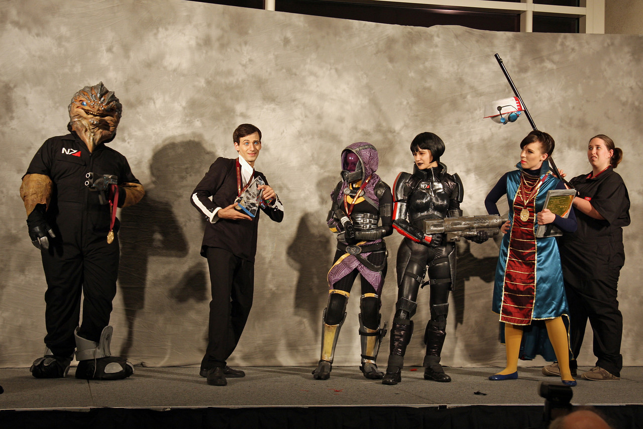 Mass Effect 2: The Suicide Mission<br /> <br /> Judges' Choice,<br /> The Testmarket Evolution: Best Anime or Video Game Representation and<br /> cosplay.com Organization Award<br /> <br /> Worn By: Holly Conrad, Tayler Hudson, Tank, Jessica Merizan, Alex Gross and Steph Werner. <br /> Designed and Made By: Crabcat Industries, a subsidiary of a company that doesn't exist.