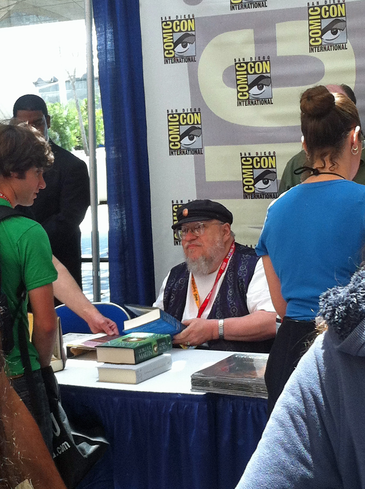 This was the crowning achievement of our entire trip. We had in our possession, a first printing, first edition copy of A Game of Thrones. In order to get the opportunity to have George R. R. Martin sign it, first we had to get up early in the morning and join a long line that would draw lots from a bag. The first time through the line we failed. However, we were allowed to go to the back of the line for a second chance. By the time we got to draw again there were just a scant few paper slips left. We were told there might be just one or two opportunities left. We each drew one slip. The first was blank, but on the second was the mark making us to be one of the few that would be allowed to get an autograph!