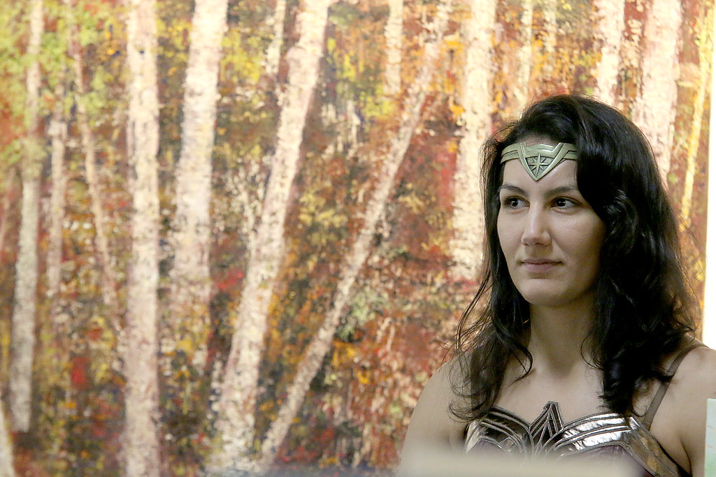 ". Gallery Sitka in Fitchburg held a ""Comics Are Art\"" show on Saturday. Serving up some drinks at the show was Patricia Rohden dressed as Wonder Woman. SENTINEL & ENTERPRISE/JOHN LOVE"