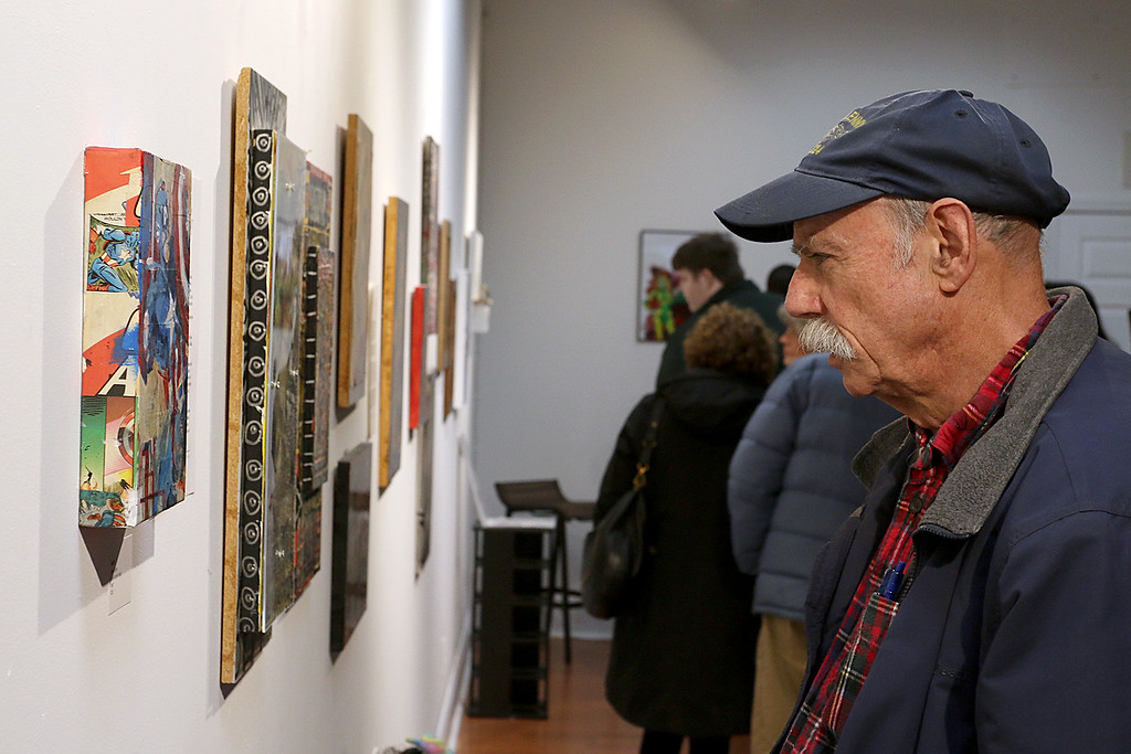 ". Gallery Sitka in Fitchburg held a ""Comics Are Art\"" show on Saturday. Pete Benson of Fitchburg takes a look at some of the are in the show. SENTINEL & ENTERPRISE/JOHN LOVE"