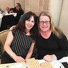 Cynthia Perrone and Kristen Ross-Sitcawich of Lowell work the raffle table.
