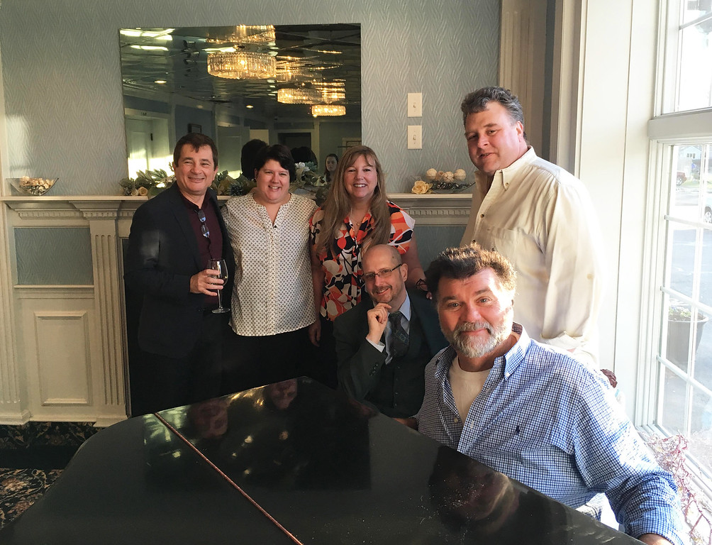 . Standing from left, comedians Brian Longwell of Natick and Carolyn Plumber of Watertown, BSBB event chairwoman and advisory-board member Brenda Maille of Lowell, and comedian Steve Bjork of Wilmington, and, seated from left, host Rick Jenkins of Cambridge and Tony V. of Charlestown