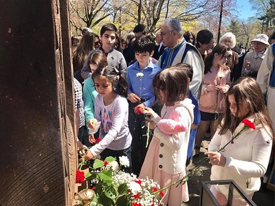 Sunday School and Armenian School students laying flowers at the base of the Martyrs monument.