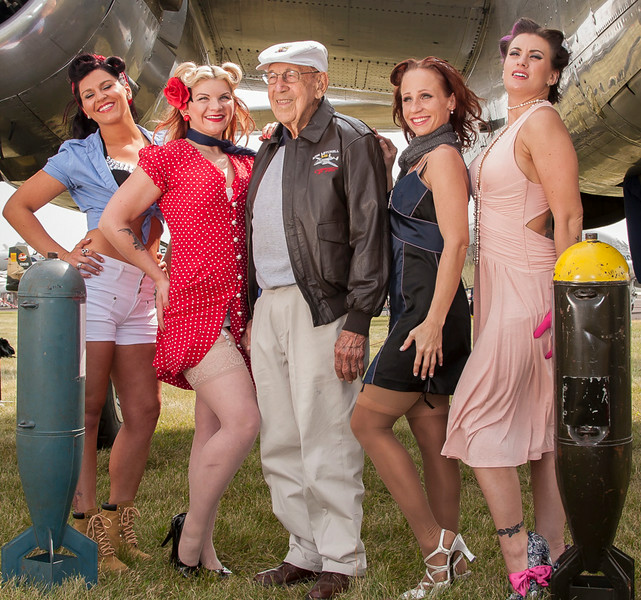 Doolittle Raider pilot Col Dick Cole photographed with pin-Up models and CAF MN Wing B-25 Miss MItchell.