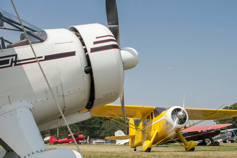 In the vintage aircraft field, a Howard DGA (Damned Good Airplane) taxi's past another Howard DGA.