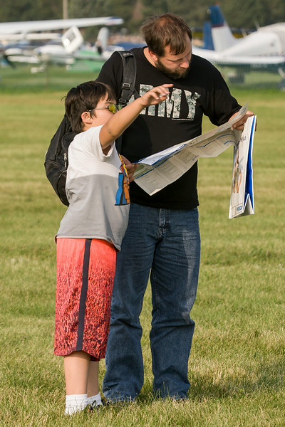 A father and son plan their day's adventure at AirVenture.