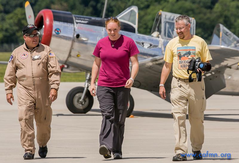 CAF Minnesota Wing Pilot Scott Belbeck (left) with Living History Flight  contributor Julia and her husband Jon after her BT-13 flight at Appleton.