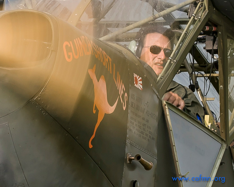 CAF pilot John Schmidt taxis the Minnesota Wing's L-5.