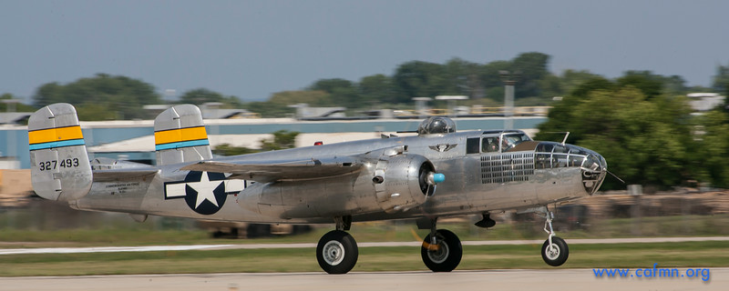 "The Minnesota Wing's B-25 ""Miss Mitchell"" takes off on Runway 18 at Oshkosh."