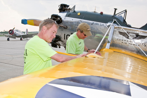 With the BT-13 in the background, CAF members Mike Schoen (left) and Greg Struve service the PT-22.