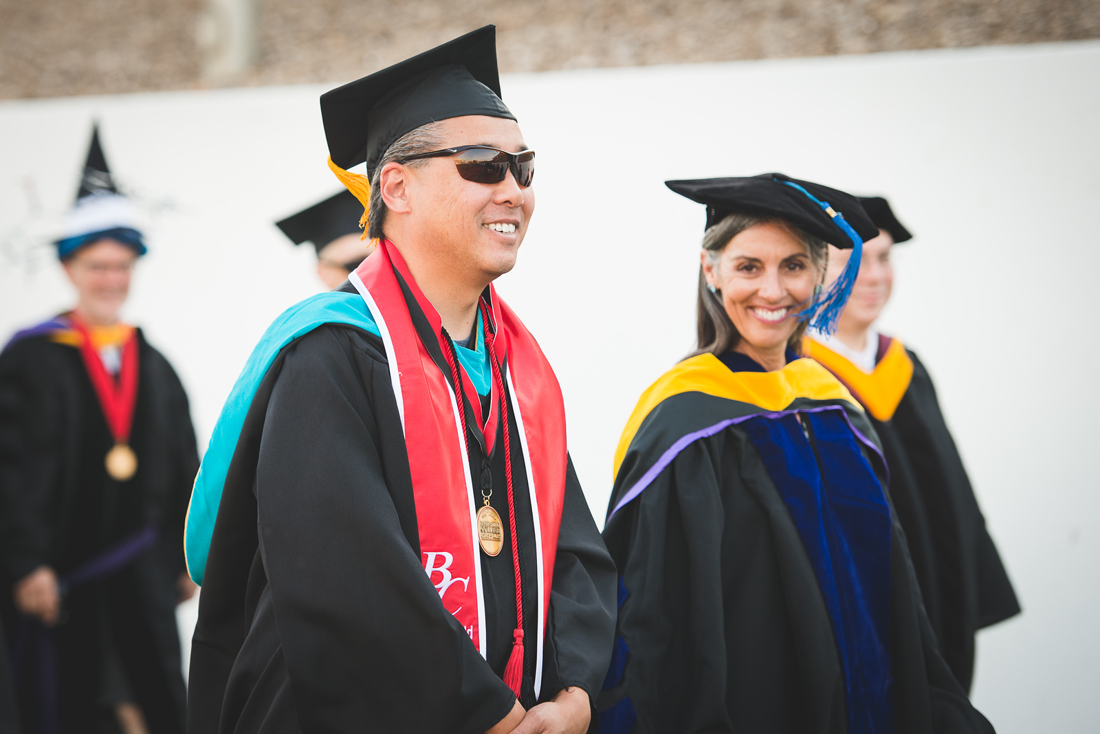 Two Faculty Smile at Commencement