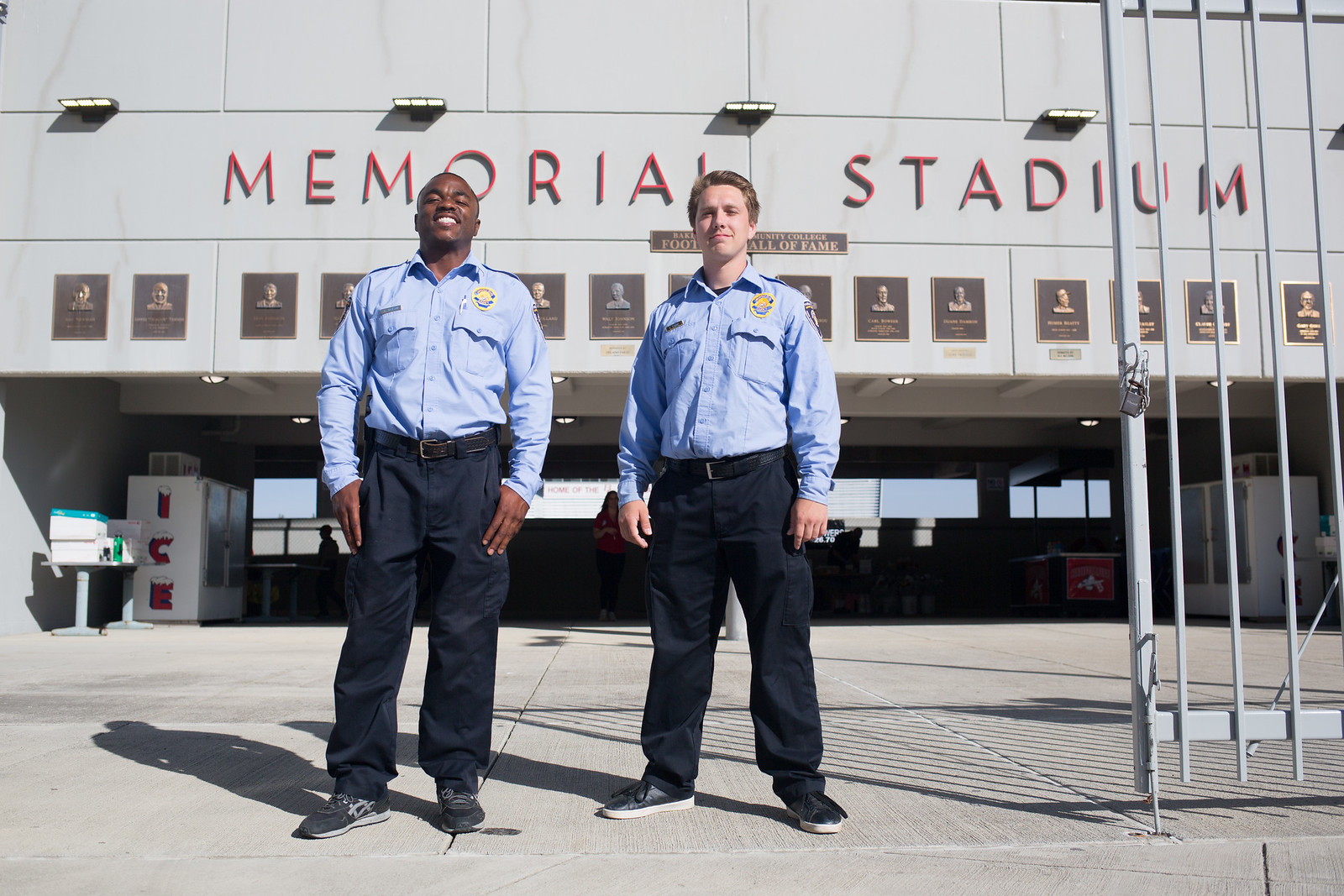 2 public safety cadets in front of Memorial Stadium.