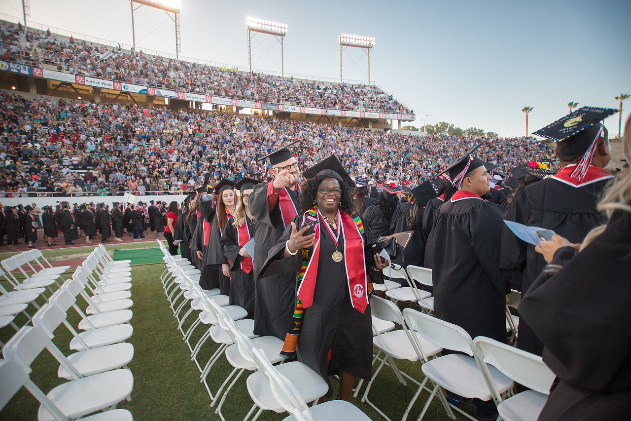 Graduates filing into their seats at Commencement in 2018