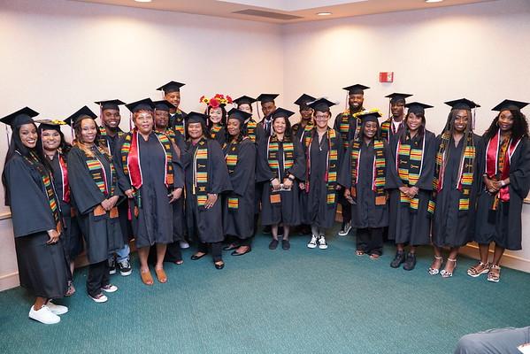 21 African-American graduates in Umoja sashes.