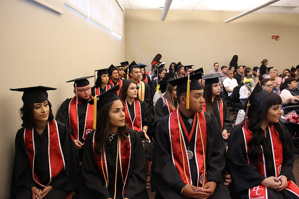 Delano graduates seated with full regalia.
