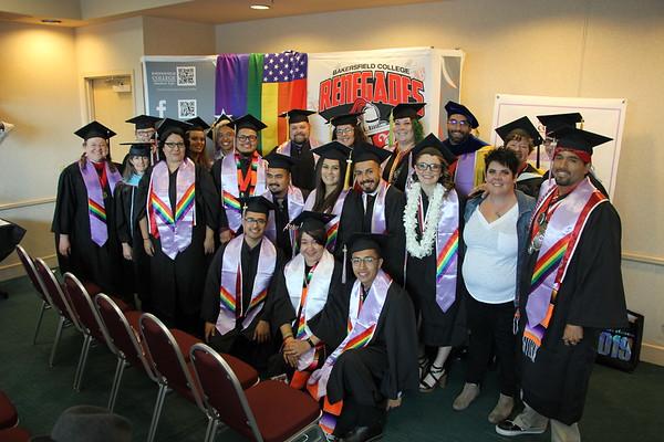 Graduates in lavender stoles.