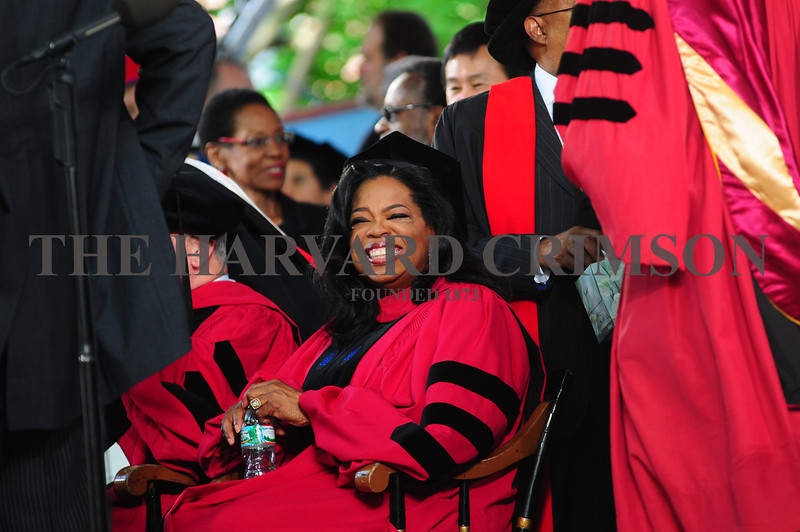 Media executive and philanthropist Oprah Winfrey sits onstage before the beginning of morning exercises. Winfrey received an honorary Doctor of Laws degree.