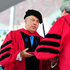 Boston's longest-serving mayor Thomas M. Menino receives an honorary Doctor of Laws degree during morning exercises on Thursday.