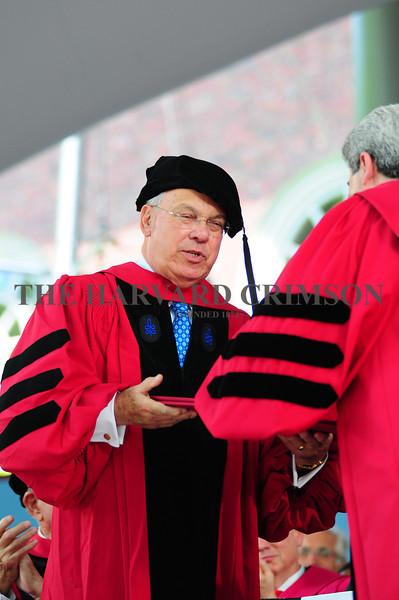 Boston's longest-serving mayor Thomas M. Menino receives an honorary Doctor of Laws degree during morning exercises on Thursday.